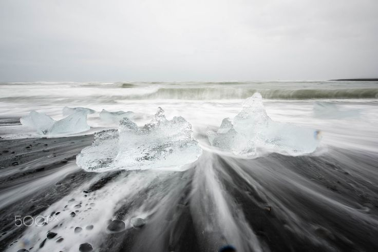 icelandic diamonds - icecubes on the beach by the glacierlgoon of jökulsarlon in the south of iceland