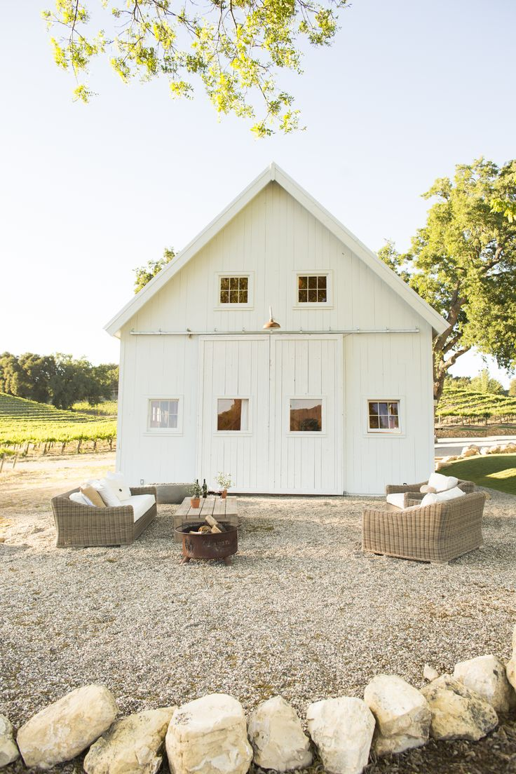White barn and outdoor sitting area, dreamy
