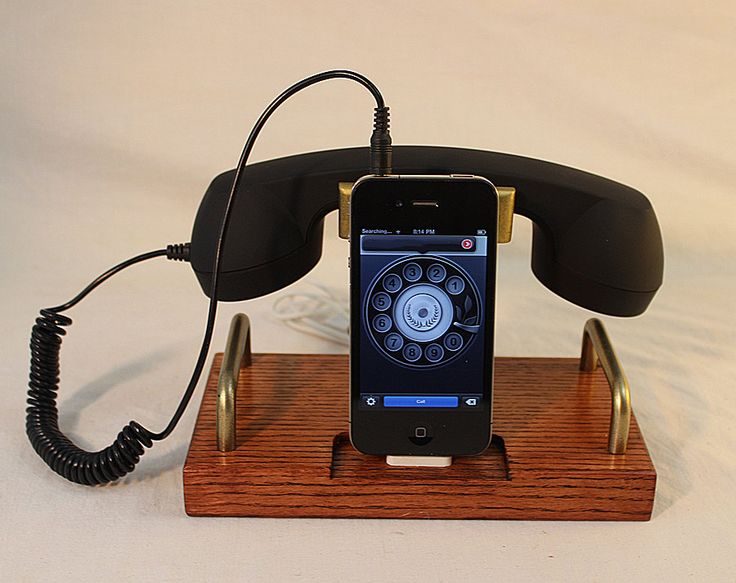 iPhone Dock - Phone - iPod Dock - Phone - Charger and Sync Station - Coiled Wire Headset B Model  -  Plugin Headset. $78.00, via Etsy.