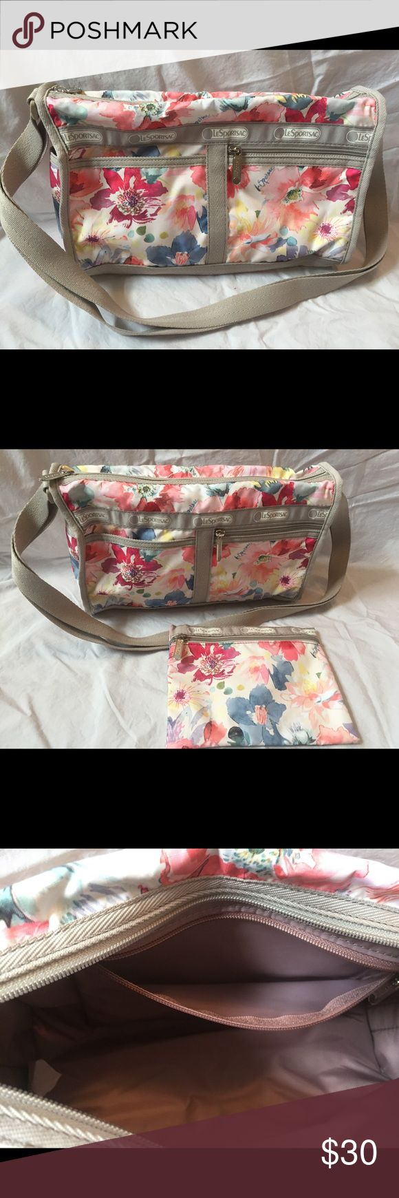 LeSportSac multi color Floral bad with pouch LeSportSac multi color Floral bag with pouch.  NWOT.  Really lightweight.  100 percent polyester  Hand wash cold water.    11 inches wide 7 inches tall 4.5 inches deep.   Can be worn cross body Lesportsac Bags Shoulder Bags