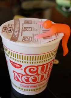 """Cupmen"" dude holds down your lid and then turns a different color when your Cup o'Noodles are ready. i dare you not to smile."