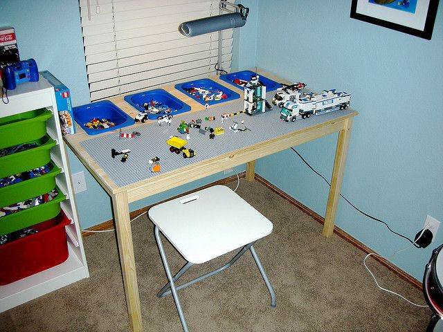 Line a table with a Lego Baseplate and cut out room for Lego bins.  Zach would love this, but by the time I would do anything about it, he will have out grown playing with Legos.