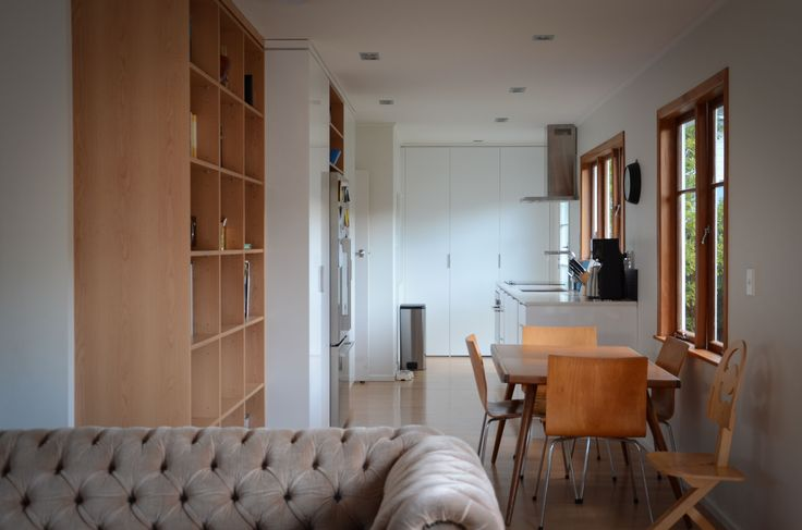 At the very end of the kitchen is a small storage cupboard and laundry, blocked off by floor to ceiling doors.