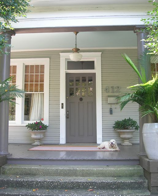 pretty grey door. like the way the door color is repeated on the porch floor and columns (my little bungalow)