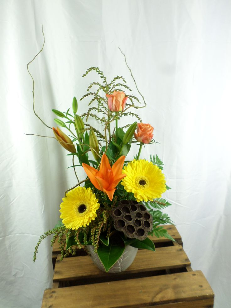 Floral table arrangement, nice a bright and bold. Created by Florist ilene