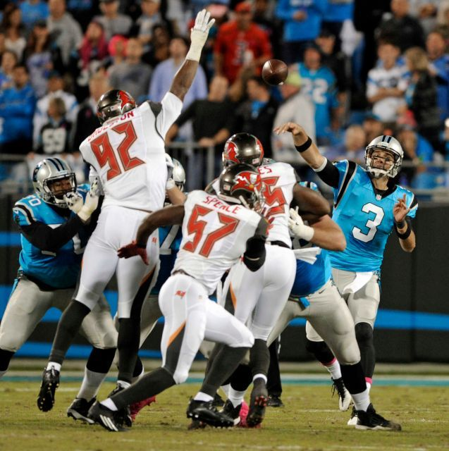 Monday Night Football: Buccaneers vs. Panthers:     October 10, 2016, 17-14, Buccaneers  -       Carolina Panthers' Derek Anderson throws a pass over Tampa Bay Buccaneers' William Gholston in the first half of an NFL game in Charlotte, N.C., Monday, Oct. 10, 2016.
