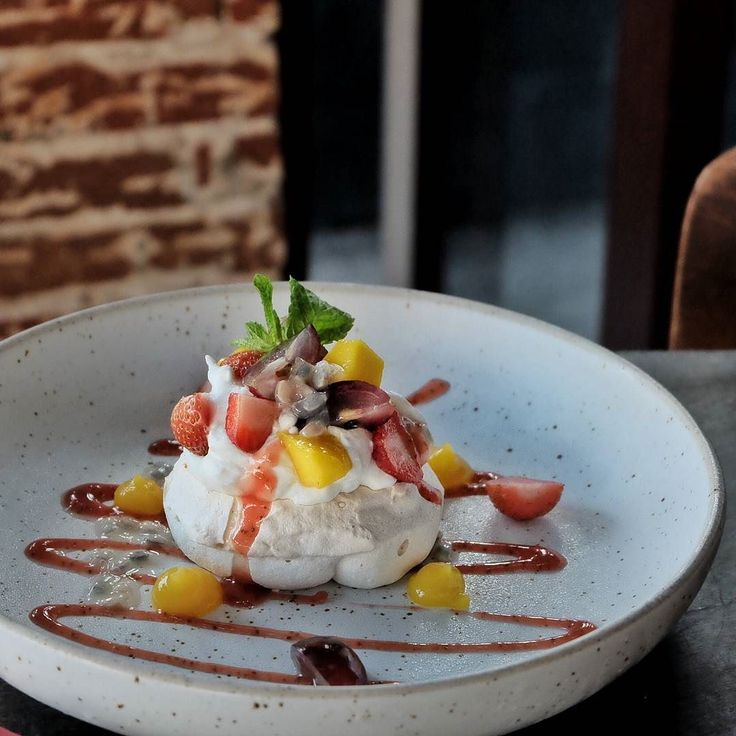 "#Bali #dessert ""Watercress Pavlova with Seasonal Fruits"" (55K) crispy crust and a melt your mouth meringue topped with tropical fruits like mango grapes strawberry and passion fruits."