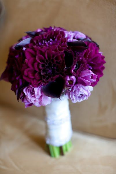 really pretty! a combination of dark purple dahlias, purple tulips, dark purple calla lilies, lavender ranunculus, and dark purple anemones wedding flower bouquet, bridal bouquet, wedding flowers, add pic source on comment and we will update it. www.myfloweraffair.com can create this beautiful wedding flower look.
