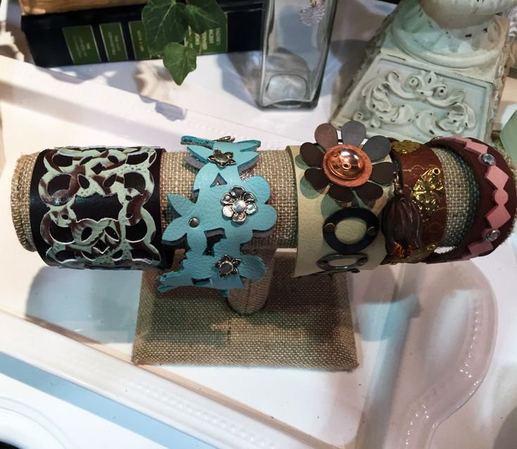 Featured in the Sizzix booth at the 2016 Bead and Button Show were finished jewelry designs, like these cuff bracelets, by artist and designer Tamara Honaman combining the Sizzix new leather cutting dies with Vintaj components. They are so beautiful!