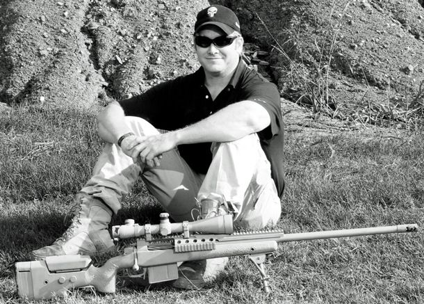 This is a picture of Chris Kyle with his favorite weapon that he used, a .300 Winchester Magnum. This was the sniper that Chris had the most kills with. He tried many other weapons, but the .300 Win Mag became his weapon of choice. Chris was not always able to use this gun when he was over seas, but if he had the choice, this was the one that he picked.