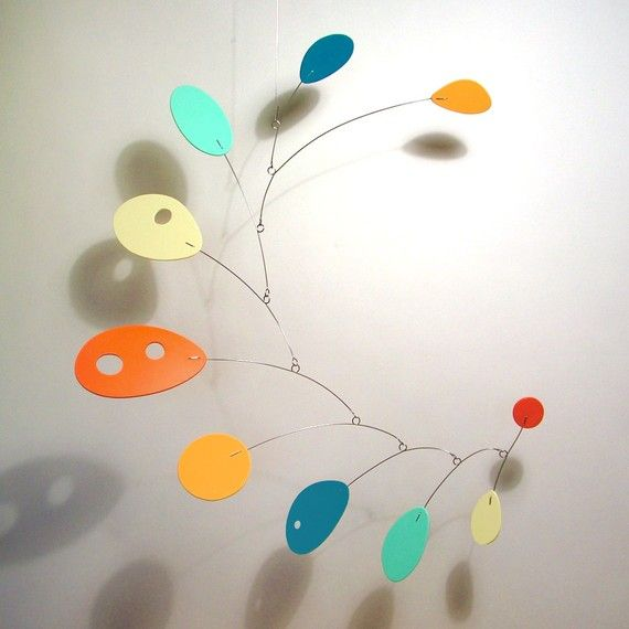 Mobile like Alexander Calder's famous large mobiles that he invented. So neat!