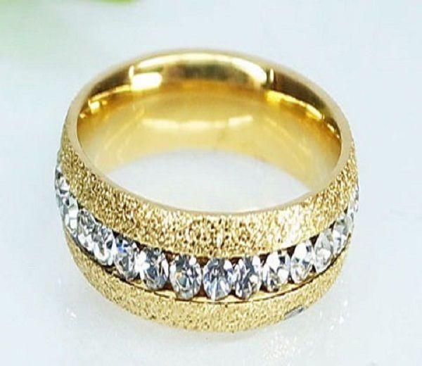 Inel placat cu aur de 18 k, 2 microni. Pietre: zirconia. Culori: alb.