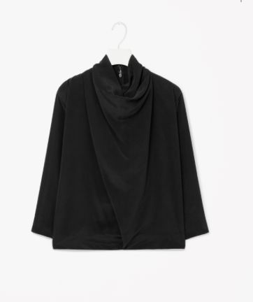Made from lightly textured silk, this top has a softly draped neckline and front. Designed to fall loosely on the body, it has tapered 3/4 sleeves and a hidden zip and hook fastening along the back.