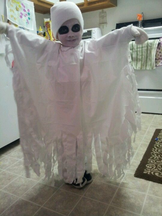 Ghost costume for my little boy it was so easy just a ripperd sheet!