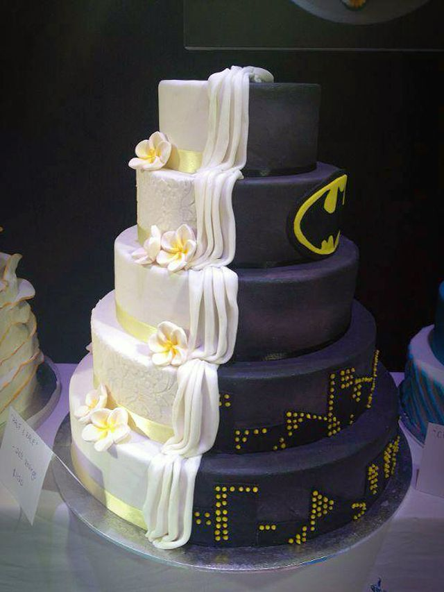 Split Cake Design is Half Batman-Themed, Half Ordinary Wedding Cake . [ BookingEntertainment.com ] #events #events #entertainment