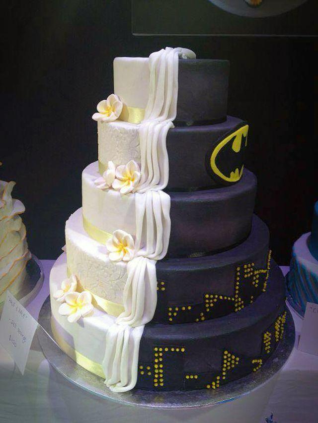 Split Cake Design is Half Batman-Themed, Half Ordinary Wedding Cake . [ BookingEntertainment.com ] #events #events #entertainment