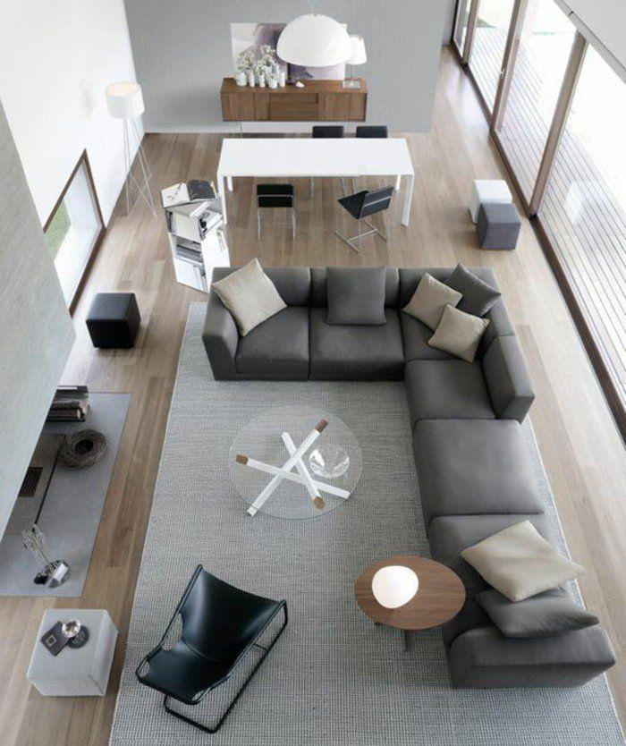 aménager salon salle à manger, canapé d angle couleur gris anthracite, tapis gris clair, sol en parquet clair