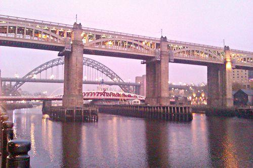 The High Level Bridge over the Tyne in Newcastle upon Tyne, England. Walking along the River Tyne at dusk: http://www.europealacarte.co.uk/blog/2011/12/29/newcastle-bridges/