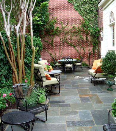Concrete Cover-Up Bob Vila Backyard Landscaping Ideas - Matt Bladshaw - For anyone who has a plain concrete patio (and, according to Matt, many of us do), there are two easy, inexpensive ways to give it a fresh look. The first is to coat the surface with masonry stain in a color of your choice, like warm honey or deep brown. You might even consider a checkerboard pattern. A second option: Lay slate tiles over the concrete with a thin-set mortar like VersaBond to create an elegant appearance.
