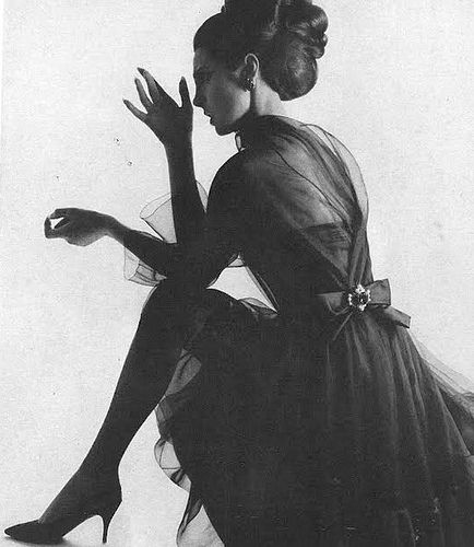 Mirella Pettini is wearing Dior's navy blue flounced organza dress, photo by William Klein for Vogue, 1965