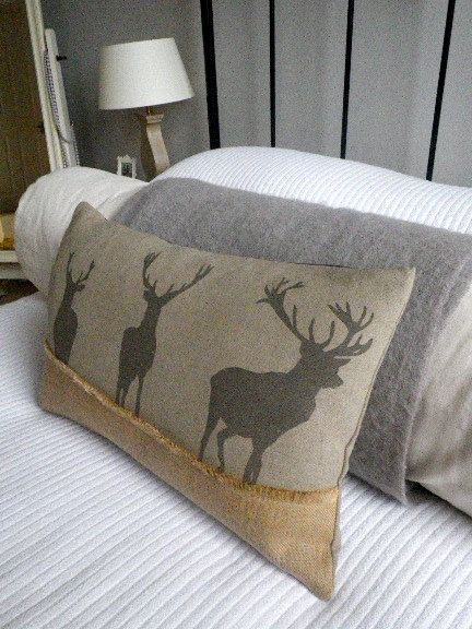 hand printed triple stags cushion cover. $74.00, via Etsy.