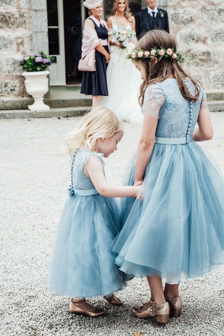 Flower girls wear blue dresses for a whimsical and romantic walled garden wedding photography by carley buick