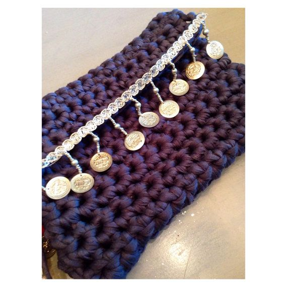 Lovely small crochet clutch with tribal details
