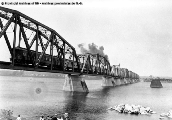 Train crossing railway bridge at Fredericton, New Brunswick. PUGH FAMILY COLLECTION, Provincial Archives of New Brunswick