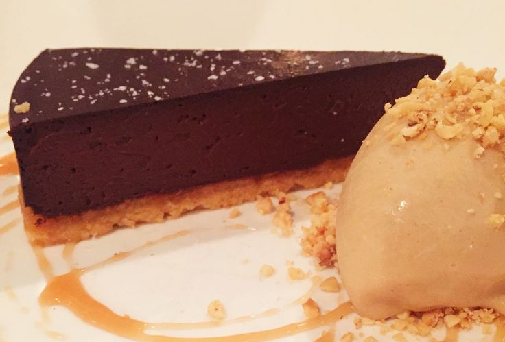 Chocolate tart with hazelnut ice cream, fluer de sel & bourbon caramel sauce