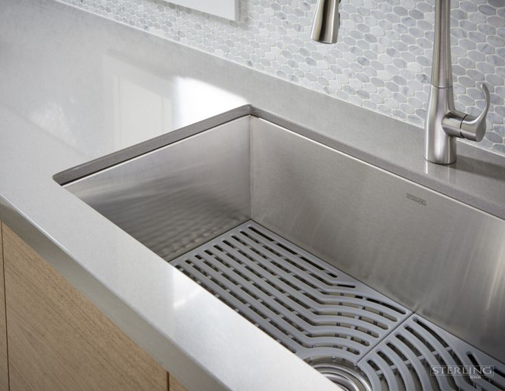 Explore available accessories for your stainless steel Ludington Sink, including a contemporary silicone mat and duo-strainer.