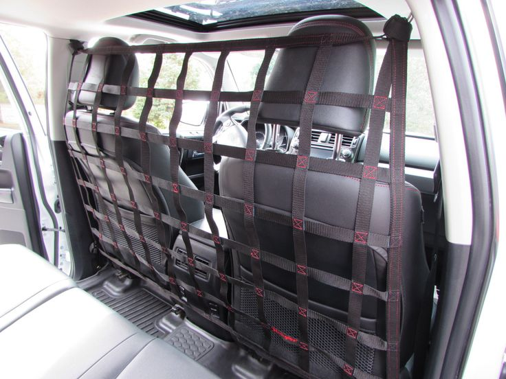 2013 - newer Mitsubishi Outlander behind front seats barrier divider