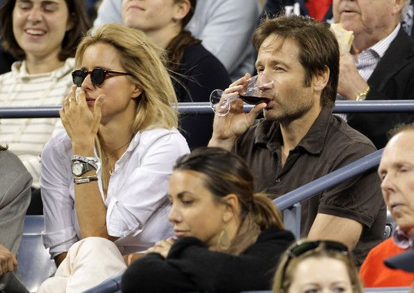 """Tea Leoni Photos Photos - David Duchovny and wife Tea Leoni show off their matching wedding tattoos as they watch the action at the US Open. Duchovny is reported to have disliked wearing a wedding ring because he """"banged it everywhere and kept hurting myself"""". He is said to have asked his wife if he could have the ring tattooed instead, and Tea liked the idea so much, she had one inked too. They both have """"AYSF"""" on their ring fingers, but neither actor will say what the initials stand for…"""