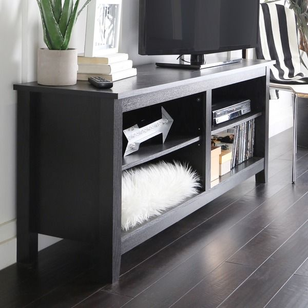 This contemporary black TV stand gives you the practicality and style you desire for your family room. High-grade MDF and sturdy laminate offer a safe place to rest your 60-inch flat panel TV without