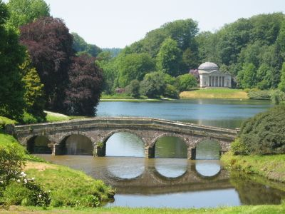 The Pantheon beyond the Palladian Bridge in Stourhead Park, Wiltshire, England reflects a dedication to a pastorally stylized estate garden popular at the time. The gardens were designed by Henry Hoare II and laid out between 1741 and 1780 in a classical 18th-century design set around a large lake, achieved by damming a small stream.
