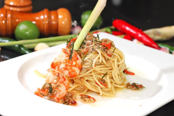 SPAGHETTI SAMBAL MATAH The pleasure of pasta with the taste of Indonesia, spaghetti cooked al dente with sambal matah made from red chili, onion, garlic, lime leaves, lime juice, lemon grass, salt and olive oil are creating a combination of spicy flavor, salty and sour served with shrimps.