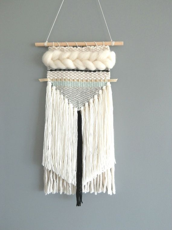 Unique mini woven wall hanging in serene tones, incorporating wool, cotton, ribbon, roving and other accent fibres. This piece measures approx 6-7