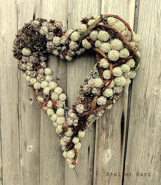 Atelier Kari natural decorations and wreaths: Heart of and with Natural Materials. [The nut-like shapes are moss balls that she rolls herself.] Unusual and lovely!