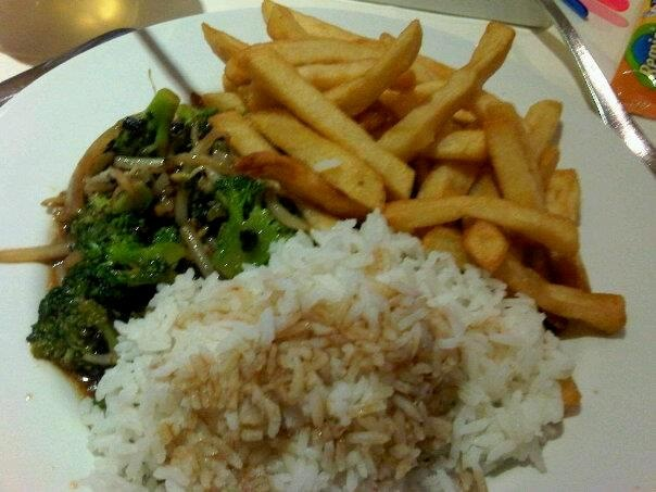 white rice with vegetables in soya saus and fries