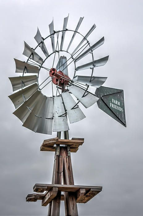 Farm Windmill Farm Friends (c) Laura Duhaime Photography  This is a wonderful farm type windmill. In early days of farming in the United States they were called windpumps or windmills. They were built in such way that they could turn slowly even in low winds. Some of these mills pumped water and powered feed mills as well as saw mills.   This is a wonderful rendition of an old type farm windmill. It is a beautiful part of old farm history and can be found in farms across New England.