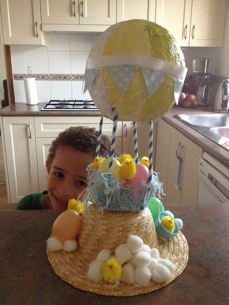 Easter hat, easter bonnet. Easy paper mâché balloon, paints, glitter, straws, plastic eggs, mini chickens, a straw hat and a bit of ingenuity. My boy made this all himself, with supervision from mum!