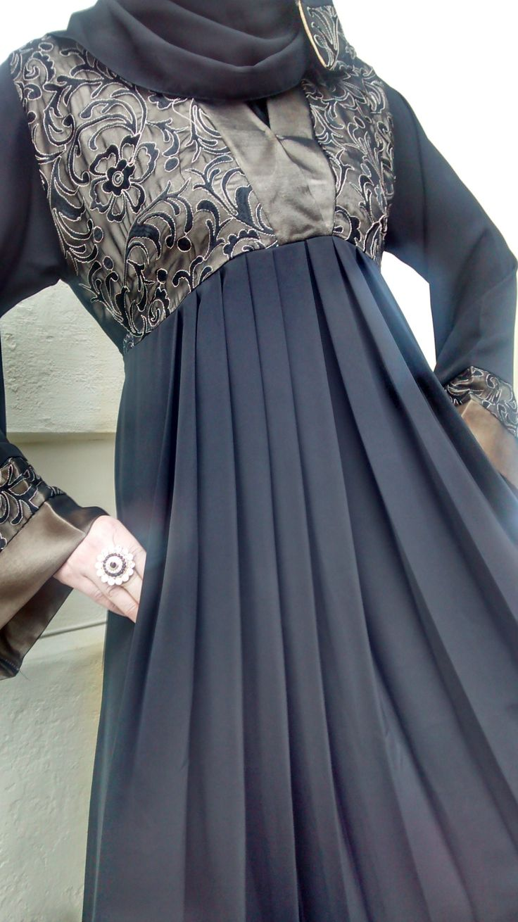 Empress Bronze Lace Abaya Empress Bronze Lace Abaya is a new addition to the ever popular Empress Collection. It's absolutely exquisite with an abundance of rich bold bronze regal embroidery lace over bronze satin on bodice and with satin trimmin