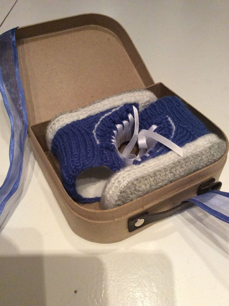 Babyboots (knitted) wrapped as a gift.