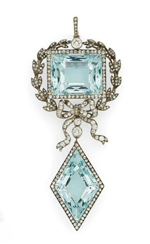 A GOLD AND SILVER-MOUNTED AQUAMARINE AND DIAMOND PENDANT BROOCH   BY FABERGÉ, WITH THE WORKMASTER'S MARK OF AUGUST HOLLMING, ST PETERSBURG, 1899-1903, SCRATCHED INVENTORY NUMBER 76389  A rectangular-shaped aquamarine within silver-cast laurel wreath surmounted with a rose-cut diamond and tied with ribbon below, suspending a lozenge-shaped aquamarine within a gold-mounted rose-cut diamond border, with suspension loop, in the original  case stamped 'Fabergé St Petersburg Moscow, Odessa'