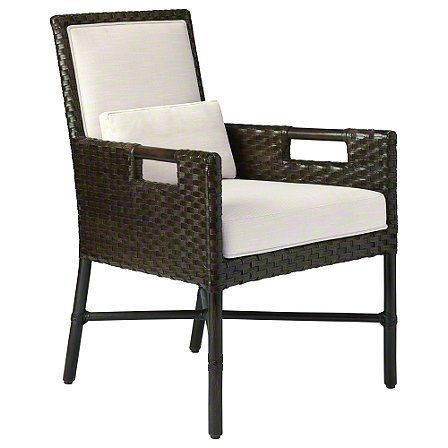 The Thomas Pheasant Woven Leather Dining Arm Chair's sleek woven design is hand-crafted, in this case using half-inch leather strips woven together in an architectural 2x2 weave. The arm chair and matching side chair are offered in a woven rattan core version in addition to the woven leather version shown. It has an upholstered back and fitted kidney pillow to maximize comfort.