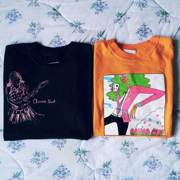 Anna Sui vintage tshirts lot of 2 Lot of 2 vintage Anna Sui tshirts. Black: size M, rockstar girl; Orange: size S, NYC girl with coffee cup and cigarette. Lightly worn.  Great condition. Anna Sui Tops Tees - Short Sleeve