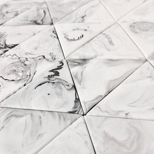 Marbled ceramic handmade tiles by Laura Itkonen.