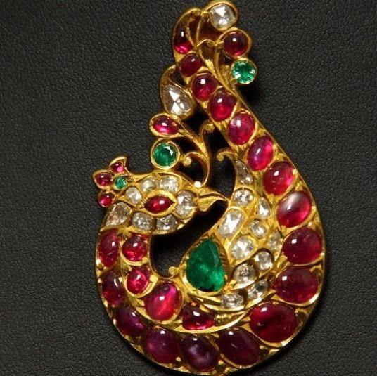 Peacock pendant of kemp,emerald and pushparagam.