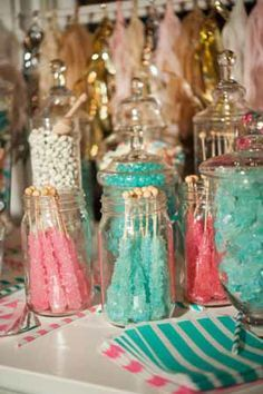 Fill mason jars with mint/coral candy, straws, pinwheels, etc. and mix n match on tables