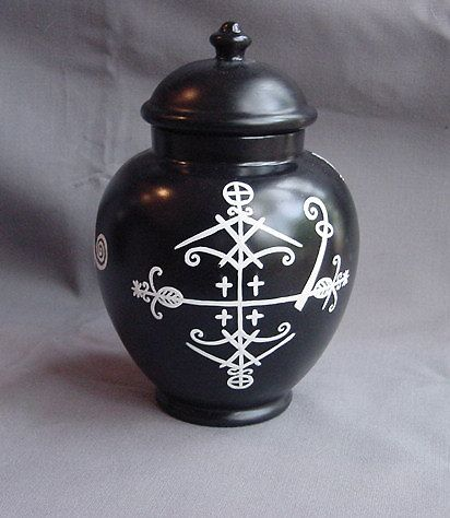 """, handpainted voodoo apothecary jar. Features 3 handpainted veves: Baron Samedi, Legba & Erzulie. 8"""" tall. Varnished. Comes complete with 29..."""