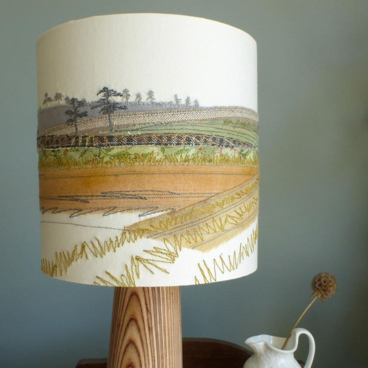 Fields of Glory lampshade. Inspired by the great British countryside and its wonderful colours, this lampshade was made using appliqué, free-motion embroidery and hand-dyed fabrics. It produces a lovely glow when illuminated.This item is handmade and one-of-a-kind.